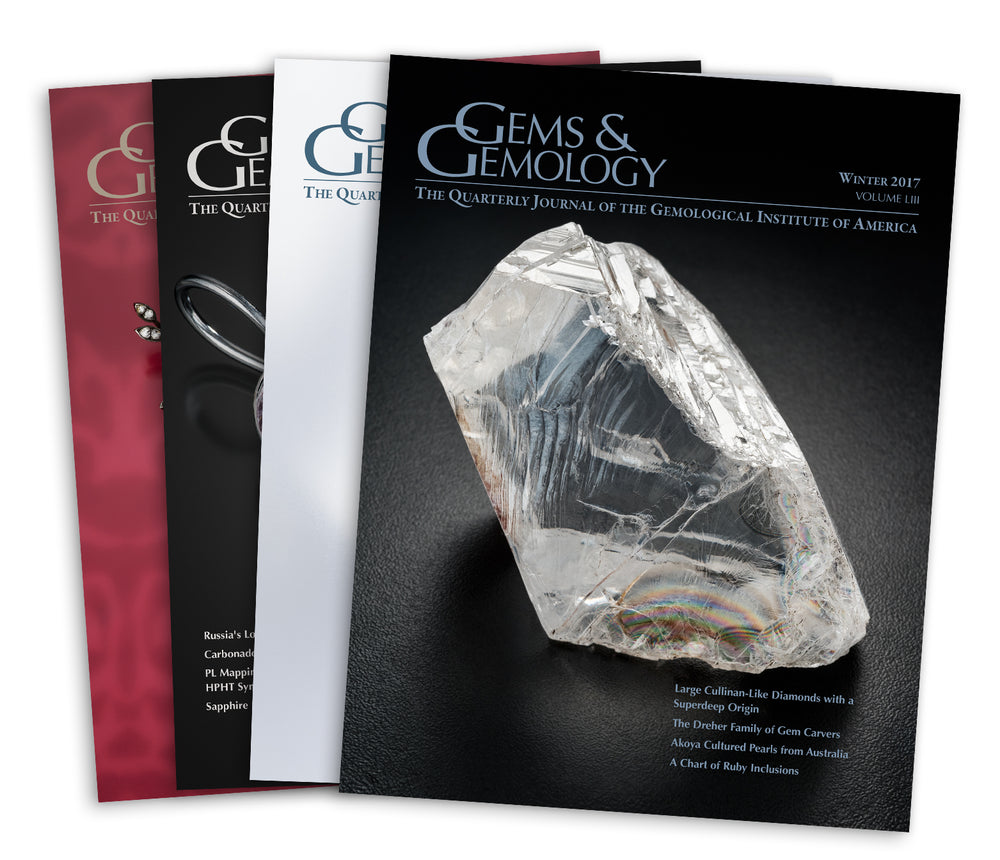 Stack of 4 2017 Gems & Gemology issues; top issue features large transparent rough gem