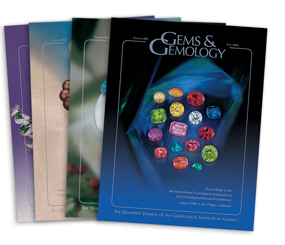 Stack of 4 2006 Gems & Gemology issues; top issue features arrangement of colored gems