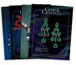 Stack of 4 2007 Gems & Gemology issues; top issue features earrings with 7 emeralds