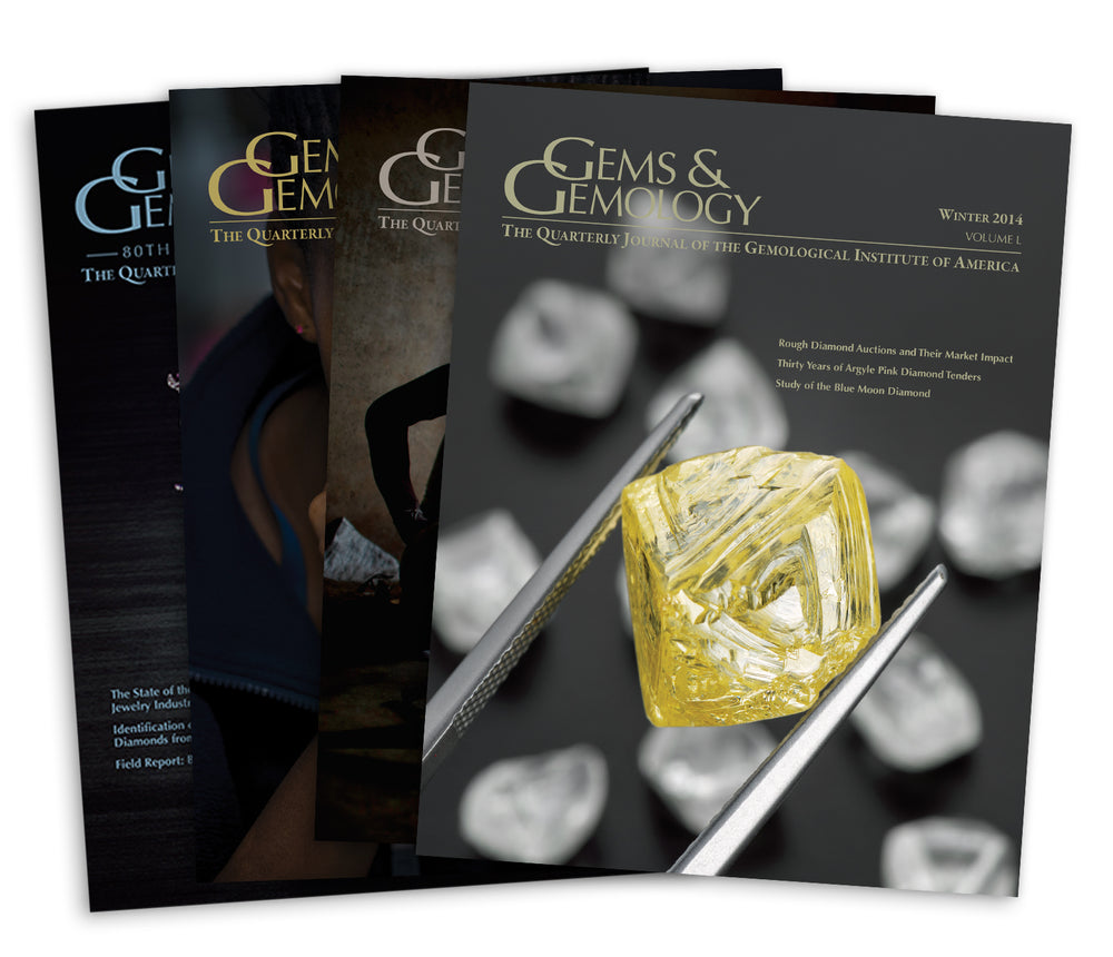 Stack of 4 2014 Gems & Gemology issues; top issue features yellow gemstone in between tweezers
