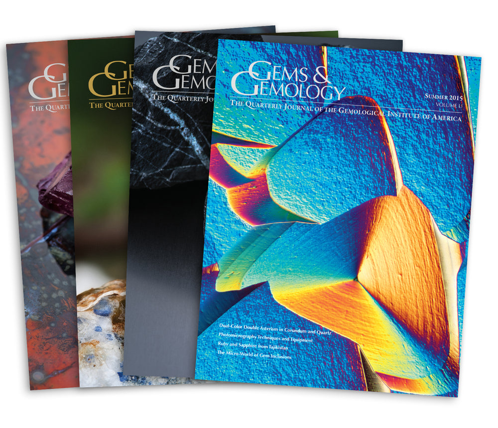 Stack of 4 2015 Gems & Gemology issues; top issue features photomicrograph of colorful surface