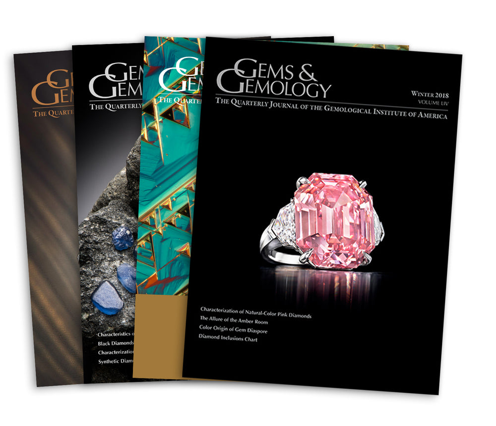 Stack of 4 2018 Gems & Gemology issues; top issue features pink ring