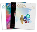 Stack of 4 2019 Gems & Gemology issues; top issue features group of gemstones over world map