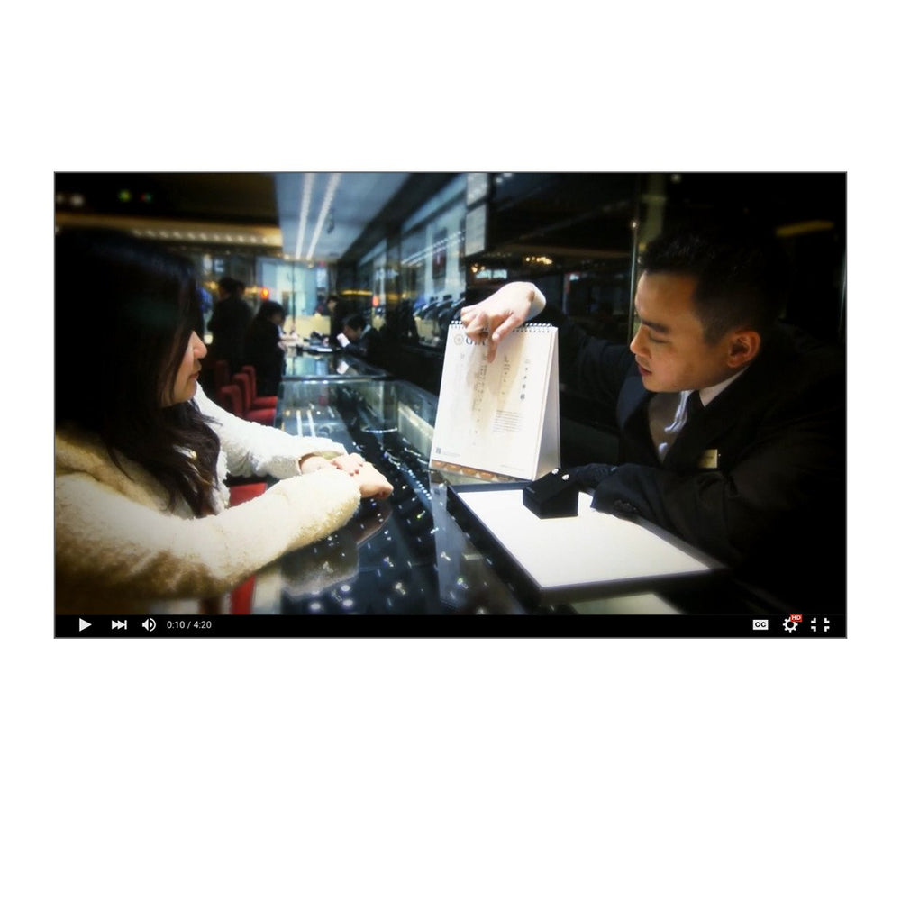Video thumbnail, featuring  jeweler using GIA 4C Counter Display to explain diamond grading to a customer