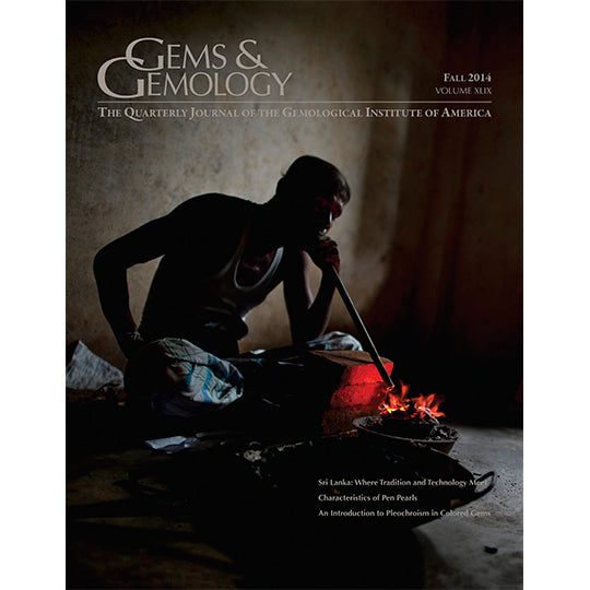Cover of Gems & Gemology Fall 2014 issue, featuring man in cave blowing through tube onto fire
