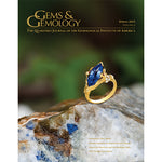 Cover of Gems & Gemology Spring 2015 issue, featuring ring with blue gem, sitting on blue-flecked stone