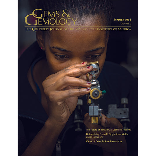 Cover of Gems & Gemology Summer 2014 issue, featuring woman gazing into gem identification tool