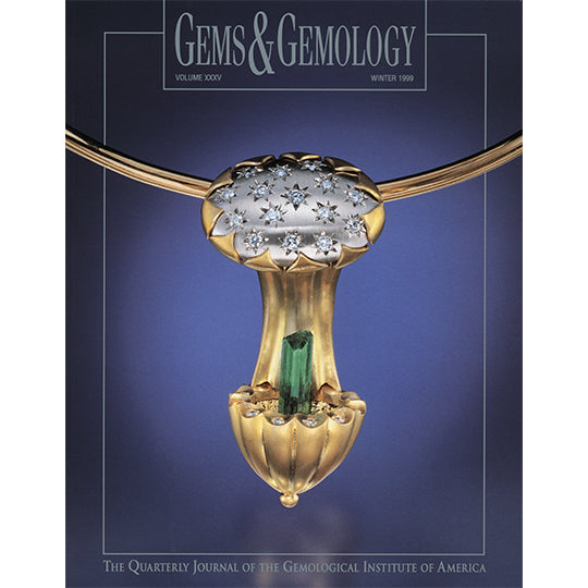 Cover of Winter 1999 Gems & Gemology issue, featuring golden art object holding cylindrical green gem