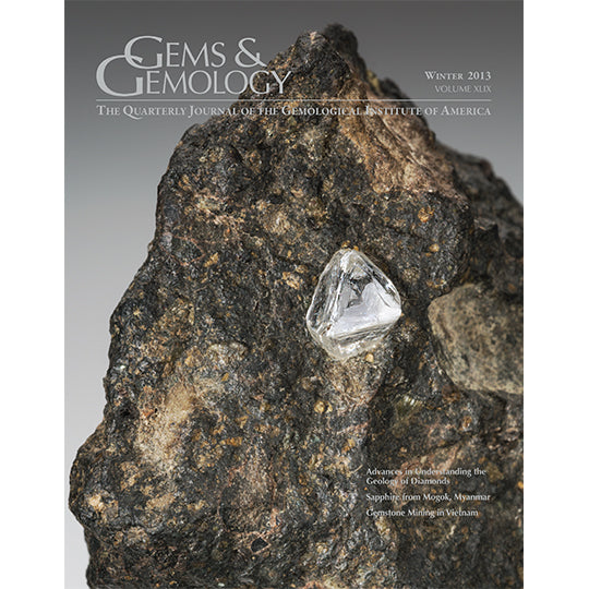 Cover of Gems & Gemology Winter 2013 issue, featuring diamond embedded in large stone
