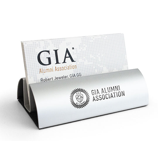 Silver business card holder with GIA Alumni Association logo