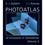 Cover of Photoatlas of Inclusions in Gemstones Volume 3, featuring black inclusion against light blue gem