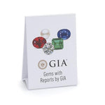 "White cardboard stand-up display with images of gems, logo, and heading ""Gems with Reports by GIA"""
