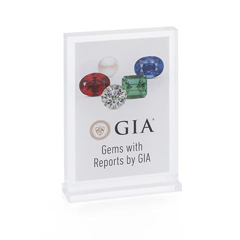 "Clear acrylic case displaying poster with gem images, logo, and heading ""Gems with Reports by GIA"""