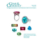 Cover of Spring 2019 issue of Gems & Gemology, featuring colored gems on pure white background