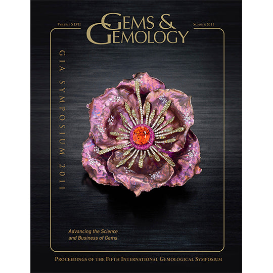 Cover of Gems & Gemology Summer 2011 issue, featuring flower art object made of metals and gemstones