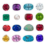 16 assorted polished gemstones lined up in neat rows