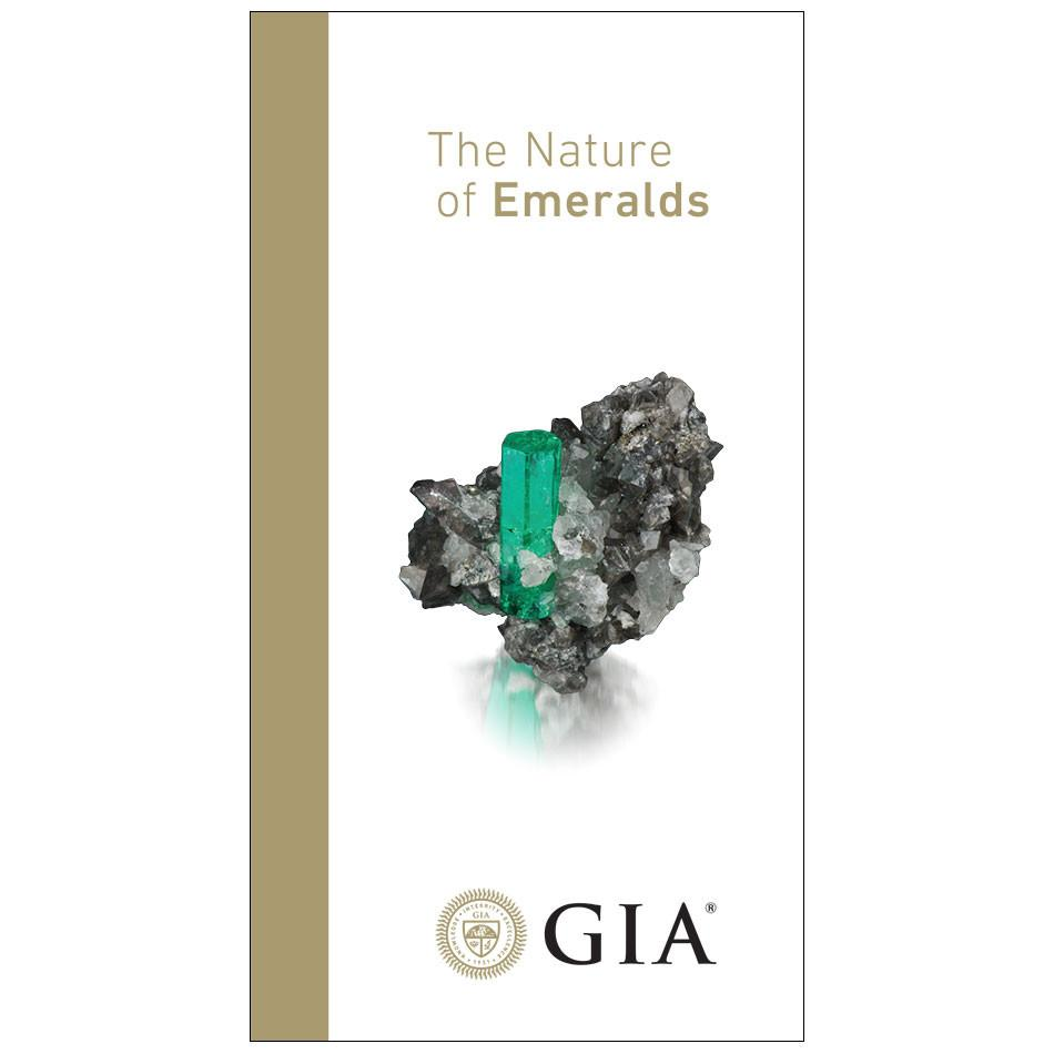 "Emerald brochure front, featuring heading ""The Nature of Emeralds"", rough emerald, and logo"
