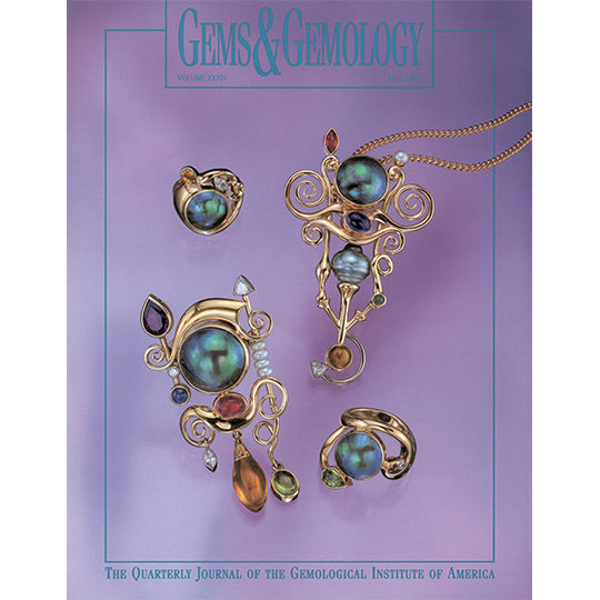 Cover of Gems & Gemology Fall 1998 issue, featuring whimsical gemstone objects and necklace