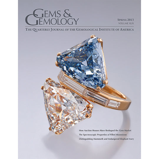 Cover of Gems & Gemology Spring 2013 issue, featuring ring with both a blue and colorless diamond