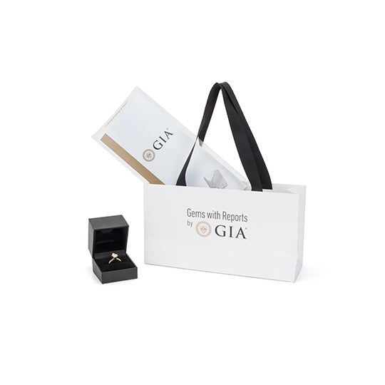 GIA shopping bag shown with pamphlet and diamond in box