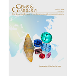 Cover of Gems & Gemology Winter 2019  issue, featuring colored gems against map of world