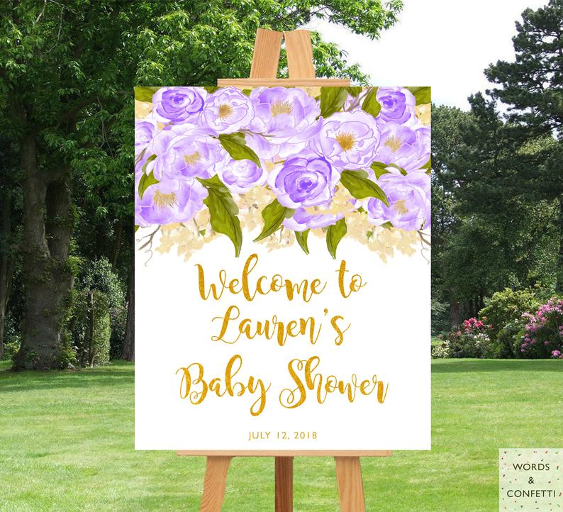 gold-and-purple-baby-shower-decorations-words-and-confetti