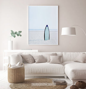 Blue Surfboard Stuck Upright in the Sand Wall Art