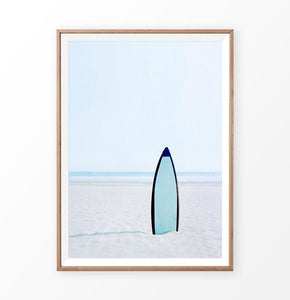 Blue Surfboard in the sand, Blue Sky and Ocean Wall Art Print
