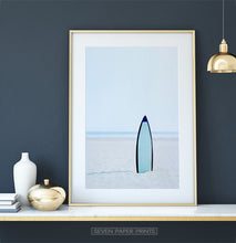 Load image into Gallery viewer, Blue Surfboard Stuck Upright in the Sand Wall Art