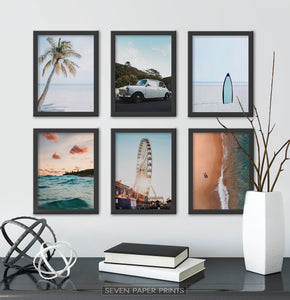 Set of 6 Black-framed posters above the black shelf