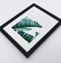 Load image into Gallery viewer, A framed photo print with banana leaves