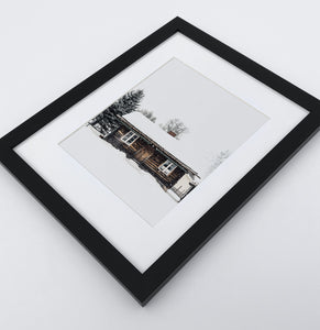 A photo print with a winter house