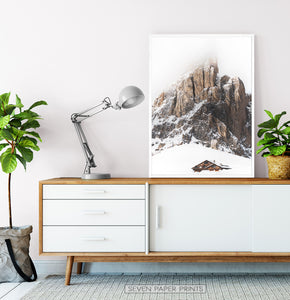 White-framed Snowy House Under A Cliff In The Mountains Wall Art