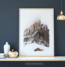 Load image into Gallery viewer, Gold-framed Snowy House Under A Cliff In The Mountains Wall Art