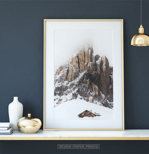 Gold-framed Snowy House Under A Cliff In The Mountains Wall Art