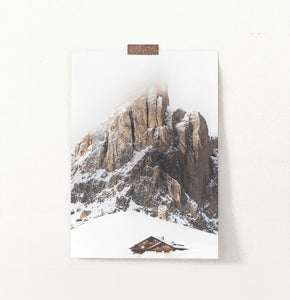 Snowy House Under A Cliff In The Mountains Wall Art
