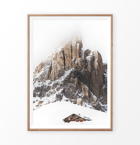 Wooden-framed Snowy House Under A Cliff In The Mountains Wall Art