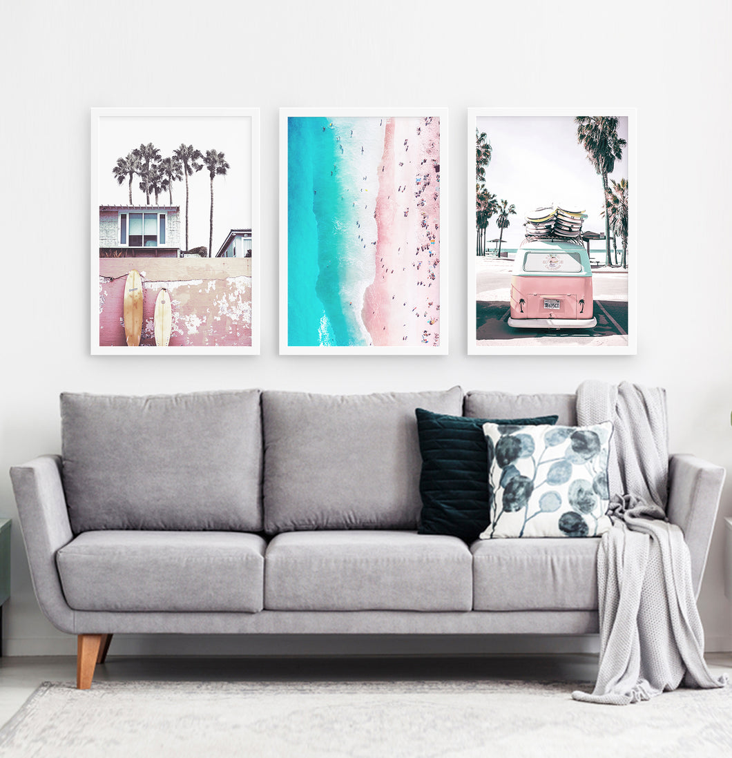 Three superb bright azure and pink photo prints of California beach house, surfing boards, a coast and a surfing miniwan in white frames