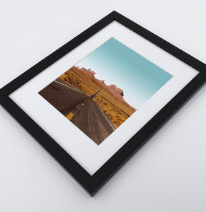 A framed photo print of a Great Canyon highway