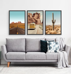Three framed photo prints of a Great Canyon highway, miniwan and a cactus