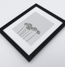 Load image into Gallery viewer, A framed photo print with palms