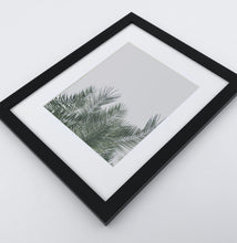 Load image into Gallery viewer, A framed photo print with palm leaves