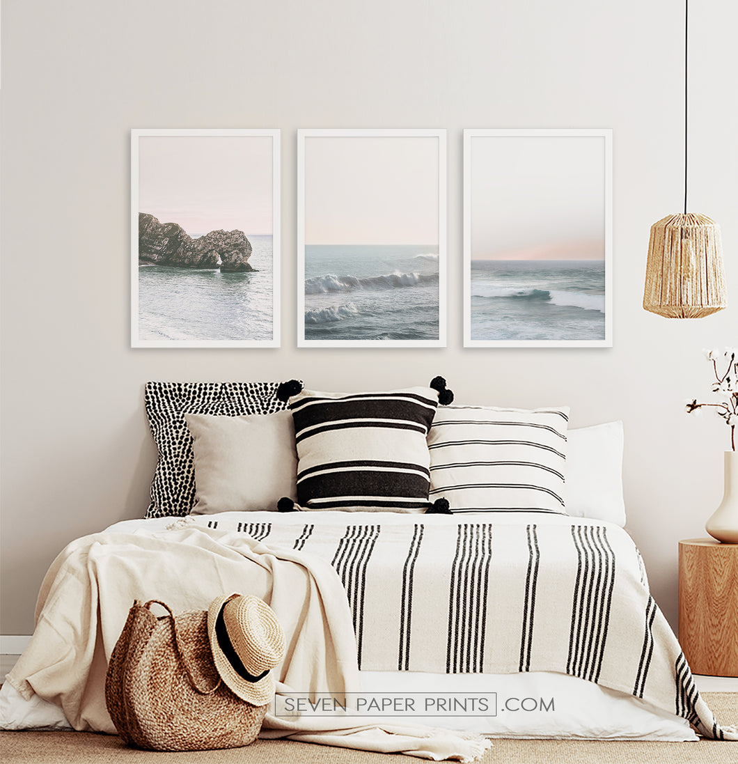 Three ocean photos in frames on a bedroom wall