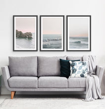 Load image into Gallery viewer, Three ocean photos in frames on a living room wall