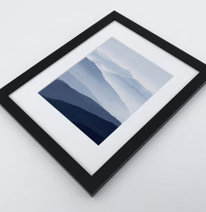 Framed Print of a Foggy Mountain Landscape