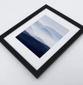 A framed Print of a Foggy Mountain Landscape 2