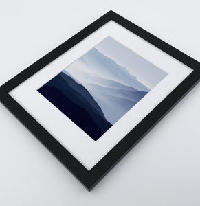 A Framed Print of a Foggy Mountain Landscape 3