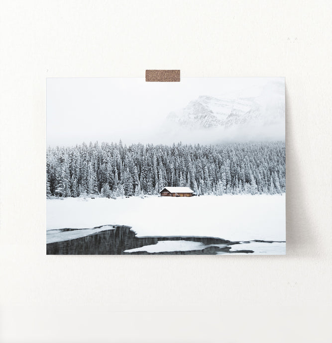 A wall art with snowy forest mountain lake landscape