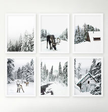 Load image into Gallery viewer, Winter mood prints. Moose, snowy forest, reindeer, river, cabin.