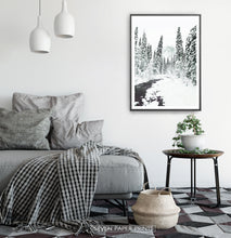 Load image into Gallery viewer, Black-framed Beautiful Winter Forest River Wall Art in the living room